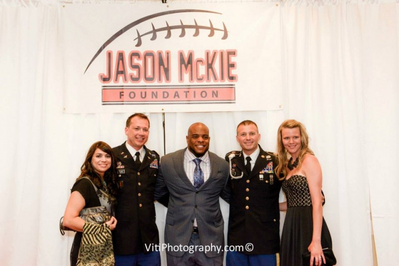 Military Men with their ladies pose with Jason
